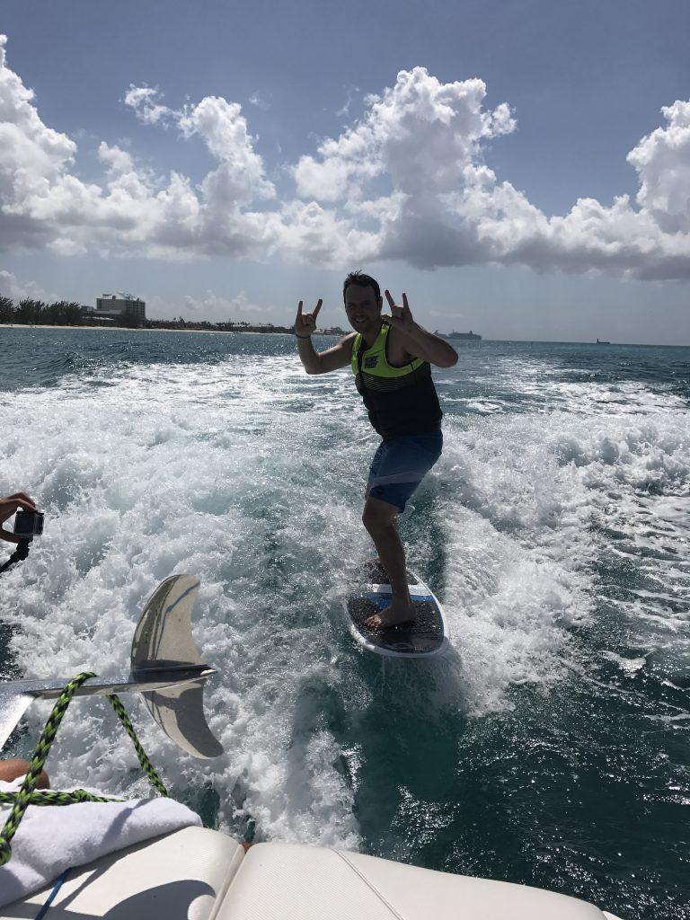 Wakesurfing behind a mastercraft in Grand Cayman